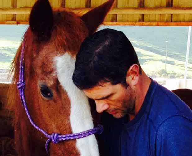 Jason with his horse.