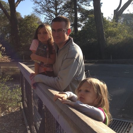 Joel at the zoo with his kids.