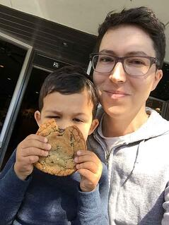 Michael enjoying a big cookie with his son.