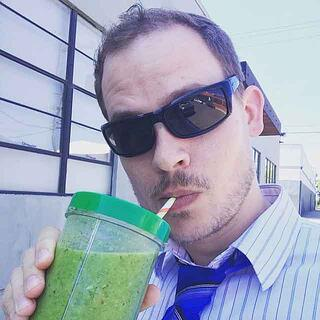 Samuel drinking a healthy smoothie outside of the Endsight office building.