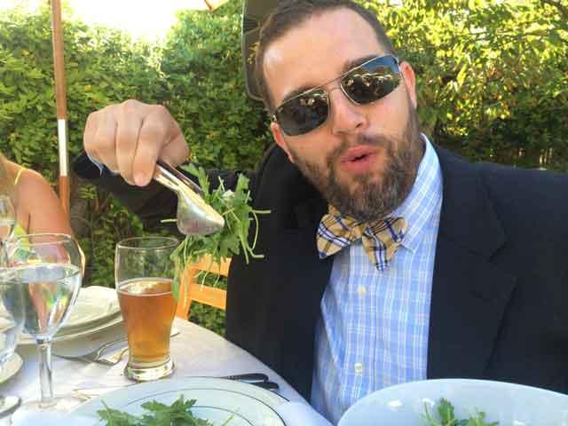 Adam eating salad.