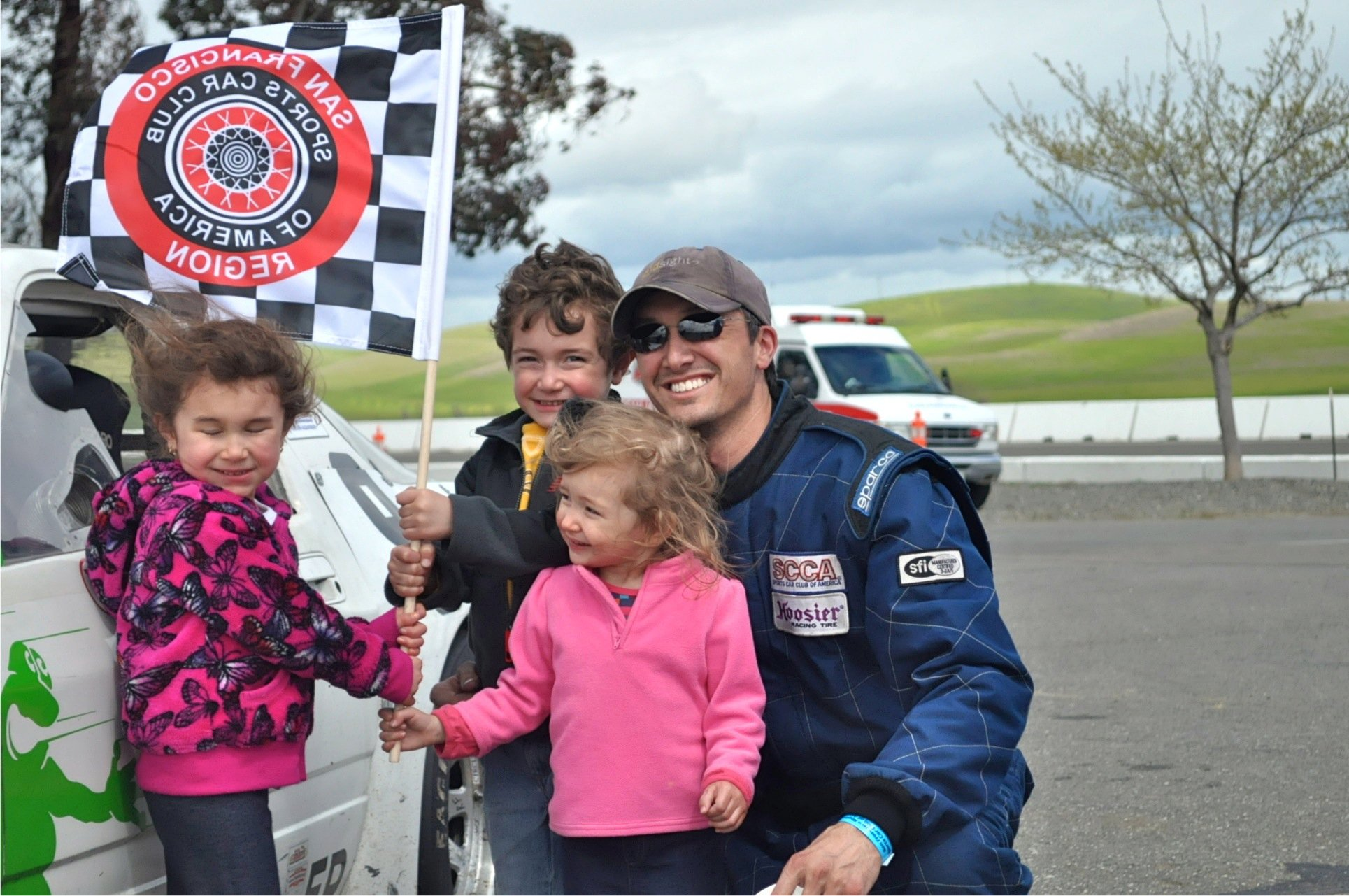 Josh at the racetrack with his kids.